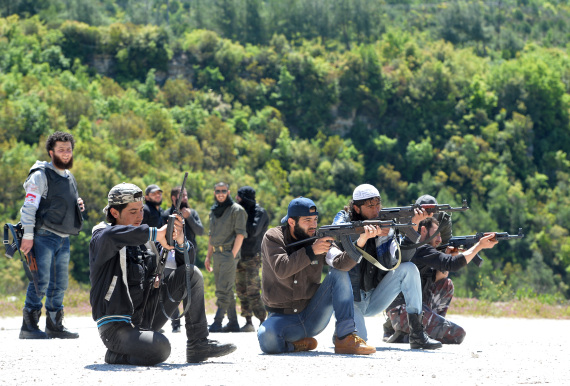 Members of the Al-Ezz bin Abdul Salam brigade take part in a training session at an undisclosed location near the al-Turkman mountains, in Syria's northern Latakia province, on April 25, 2013. AFP  PHOTO / MIGUEL MEDINA        (Photo credit should read MIGUEL MEDINA/AFP/Getty Images)
